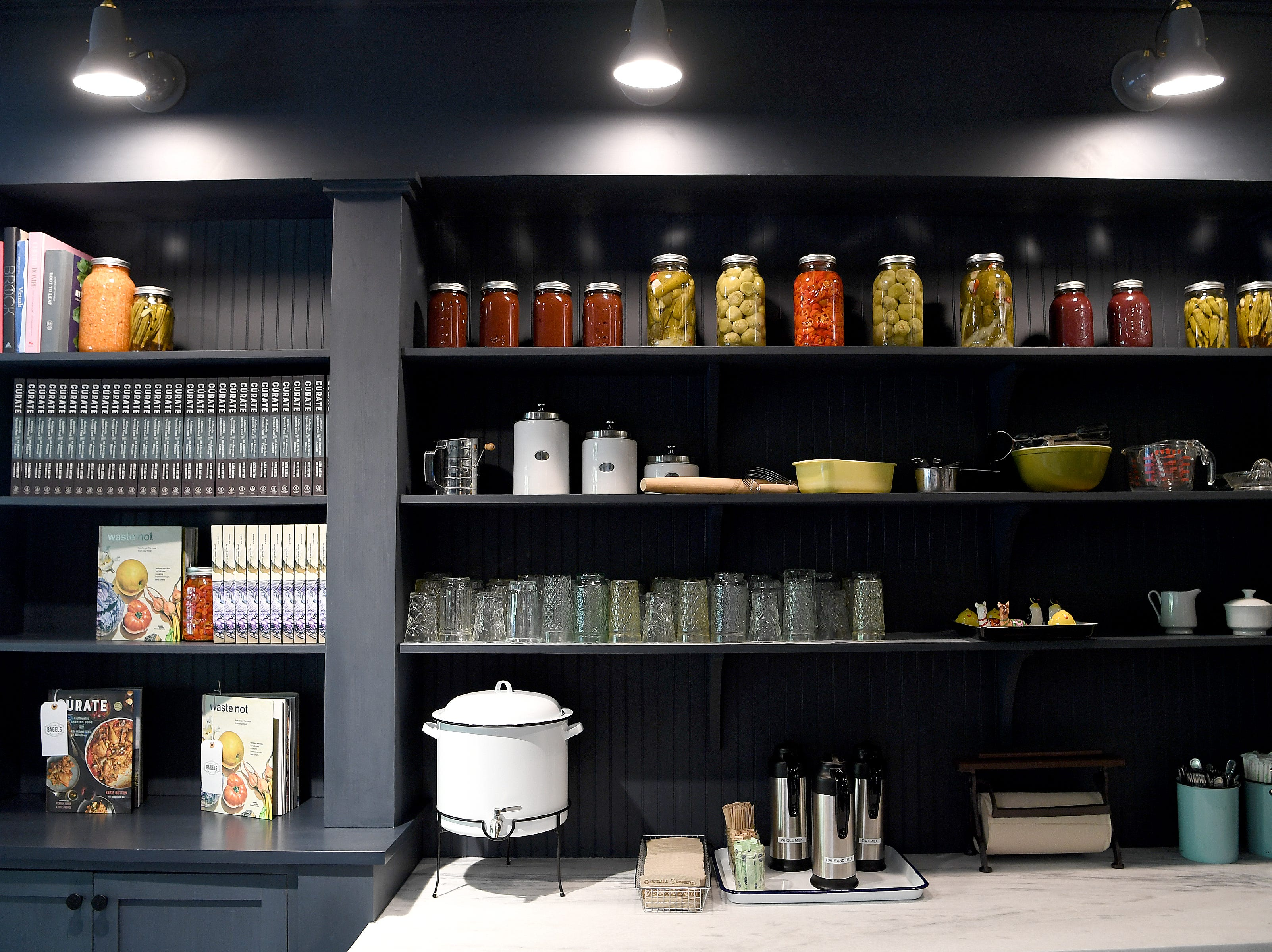 Cookbooks are for sale and jarred vegetables being used by the restaurant are on display at the soon-to-open Button & Co. Bagels on Lexington Avenue.