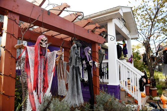 Paula Beatty and Jan Walker decorate their yard for Halloween in West Asheville.