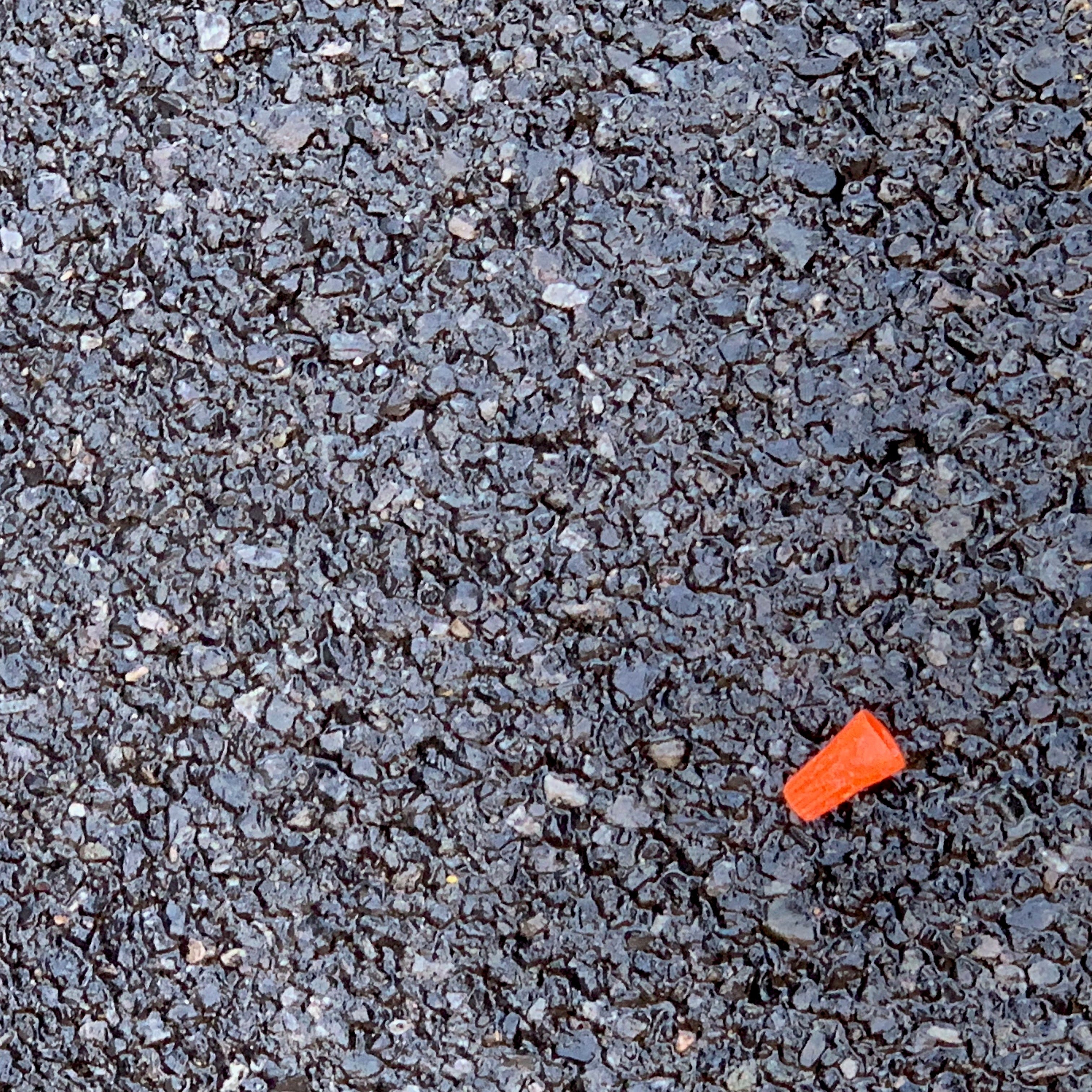 The cap to a hypodermic needle spotted in a restaurant parking lot in downtown Binghamton.