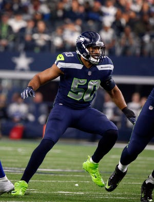 Seahawks outside linebacker K.J. Wright during a game against the Cowboys on Christmas Eve 2017. Wright is expected to make his 2018 season debut on Sunday in Detroit.