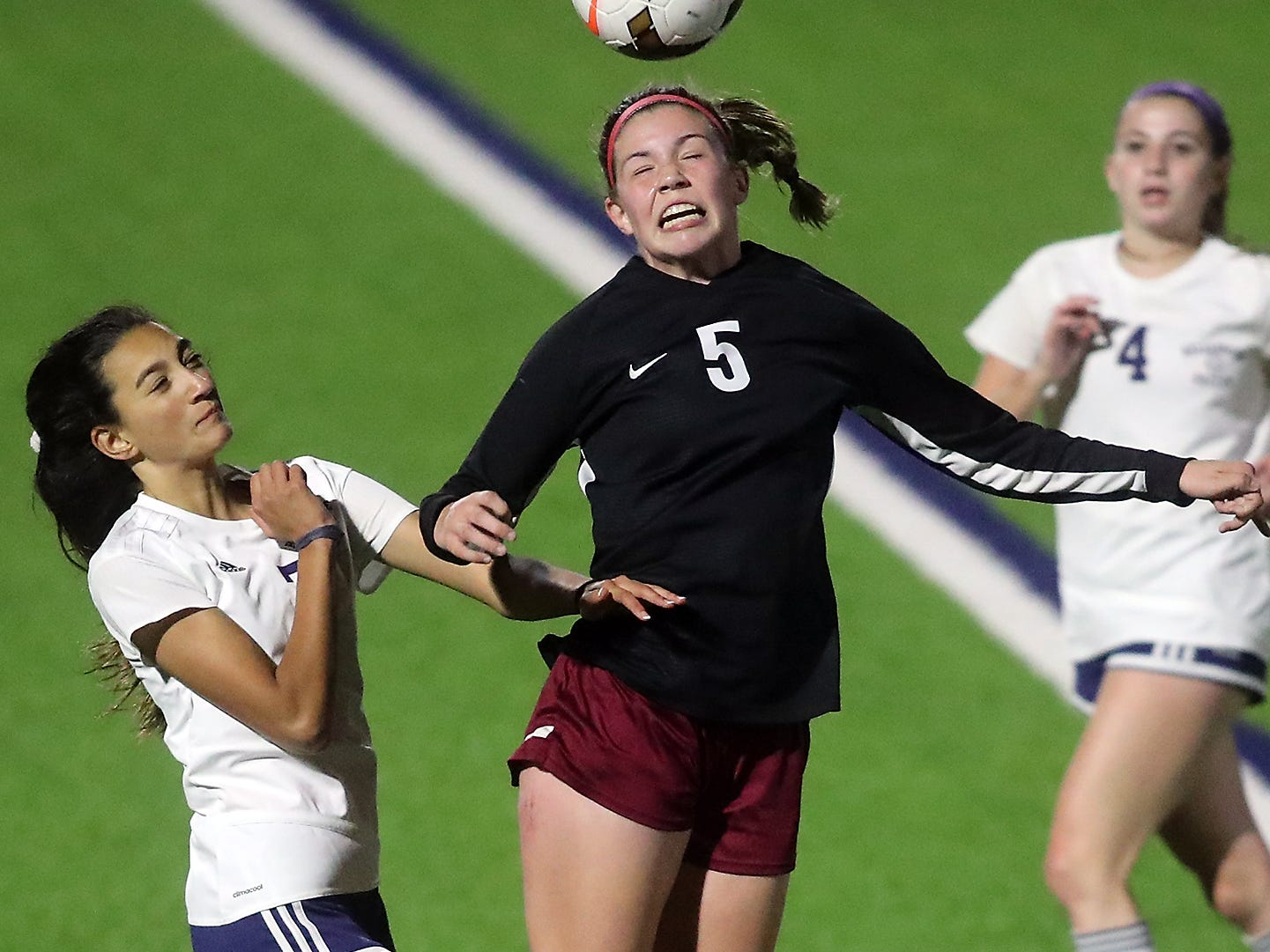 South Kitsap's Sierrah VanGesen (5) connects with a header over Bellarmine's Acacia Judkins during the first half of their game in Port Orchard on Tuesday, October 23, 2018. Bellarmine won the game 1-0.