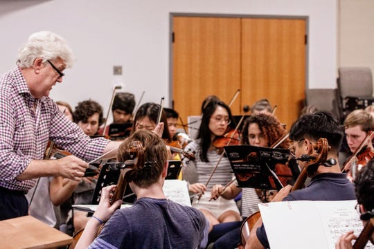 """Director Mark Nelson works with the advanced students of the Philharmonic Orchestra.  All three groups of the 98-member Space Coast Symphony Youth Orchestra will perform during """"Fanfares & Salutations"""" on Nov. 4."""
