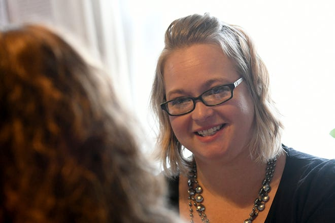 Eliza Cole, executive director of BORN, speaks with a client Wednesday at the BORN offices in Bucyrus.