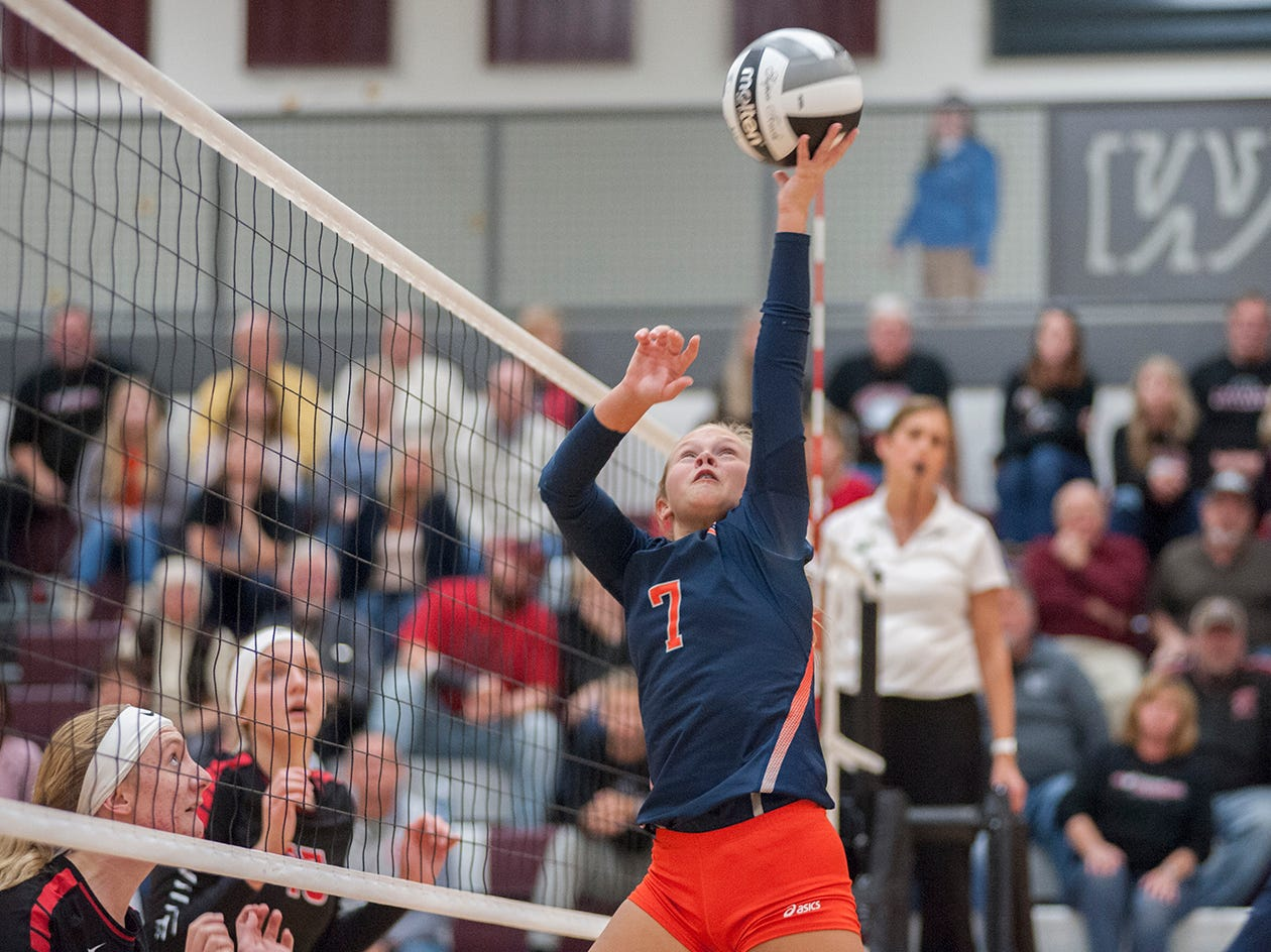 Galion's Kayla Hardy reaches to tip a ball over the net.