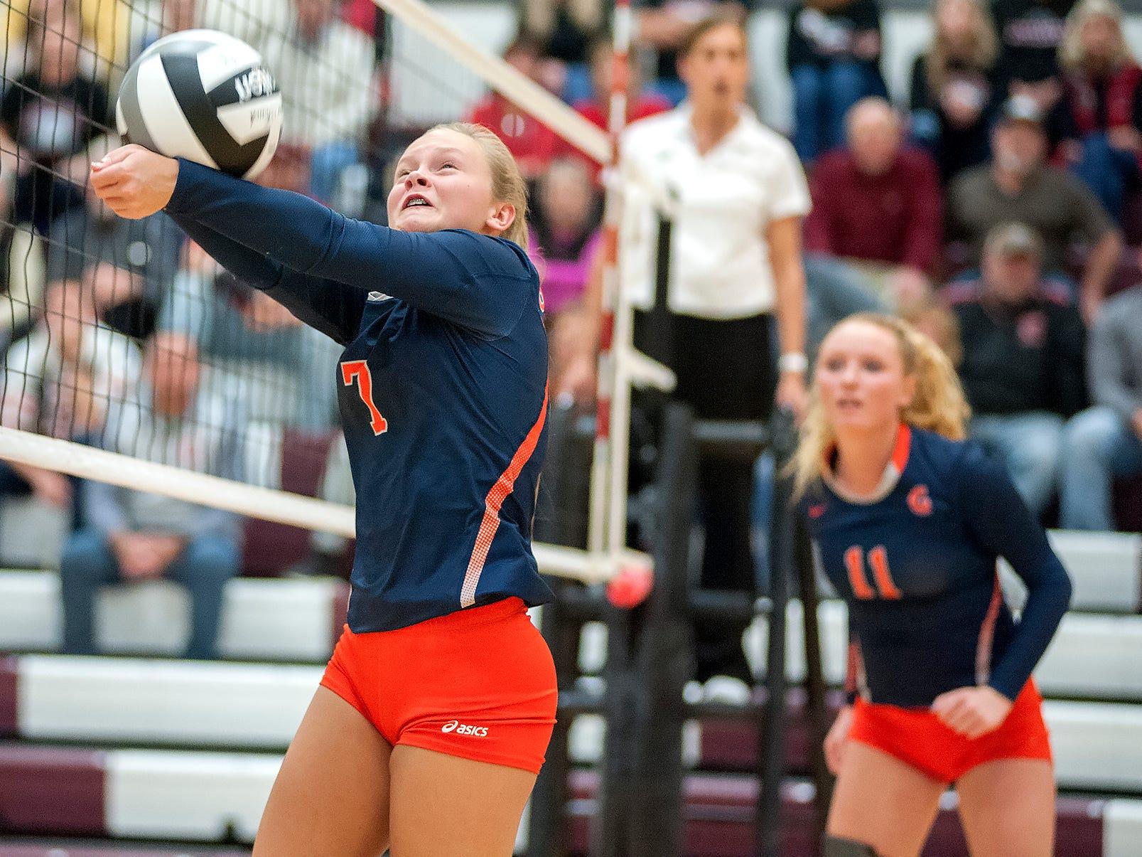 Galion's Kayla Hardy sets a teammate at the net.