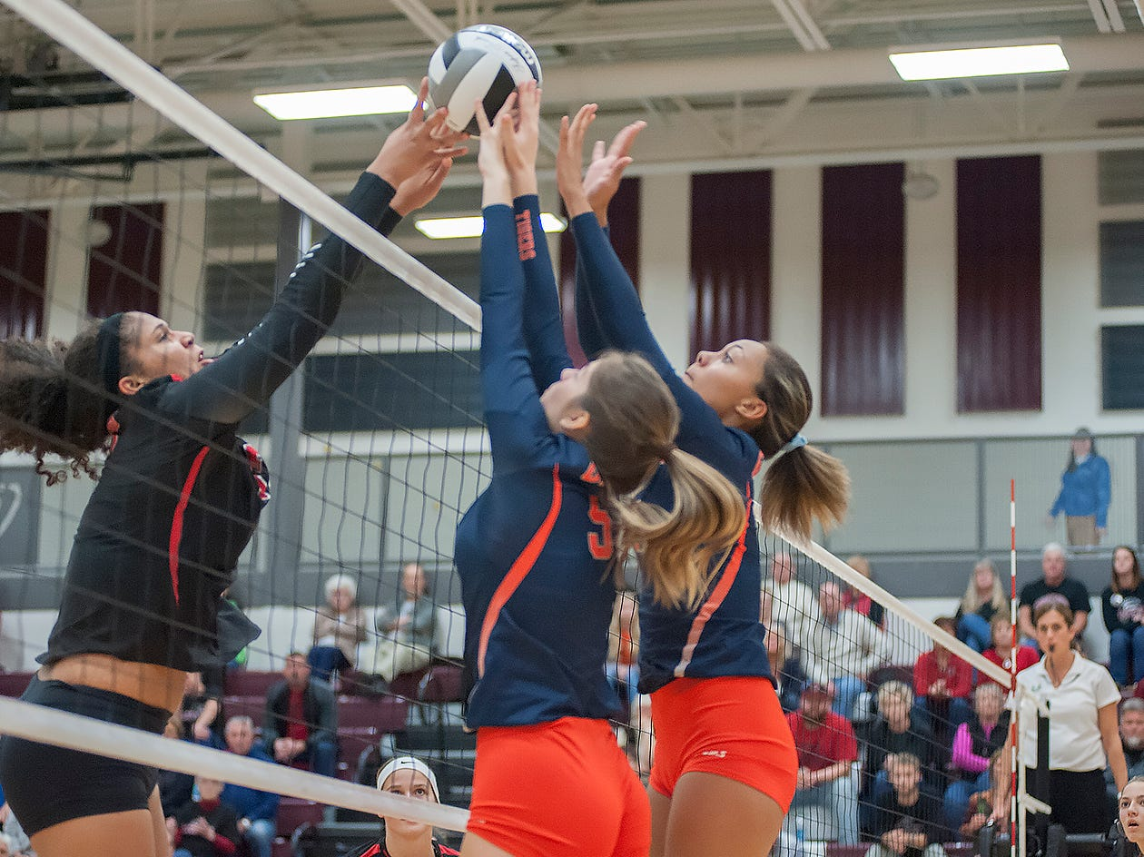 Galion's Gillian Miller and Brooklyn Cosey block a tip from Crestview's Kyla Brafford.