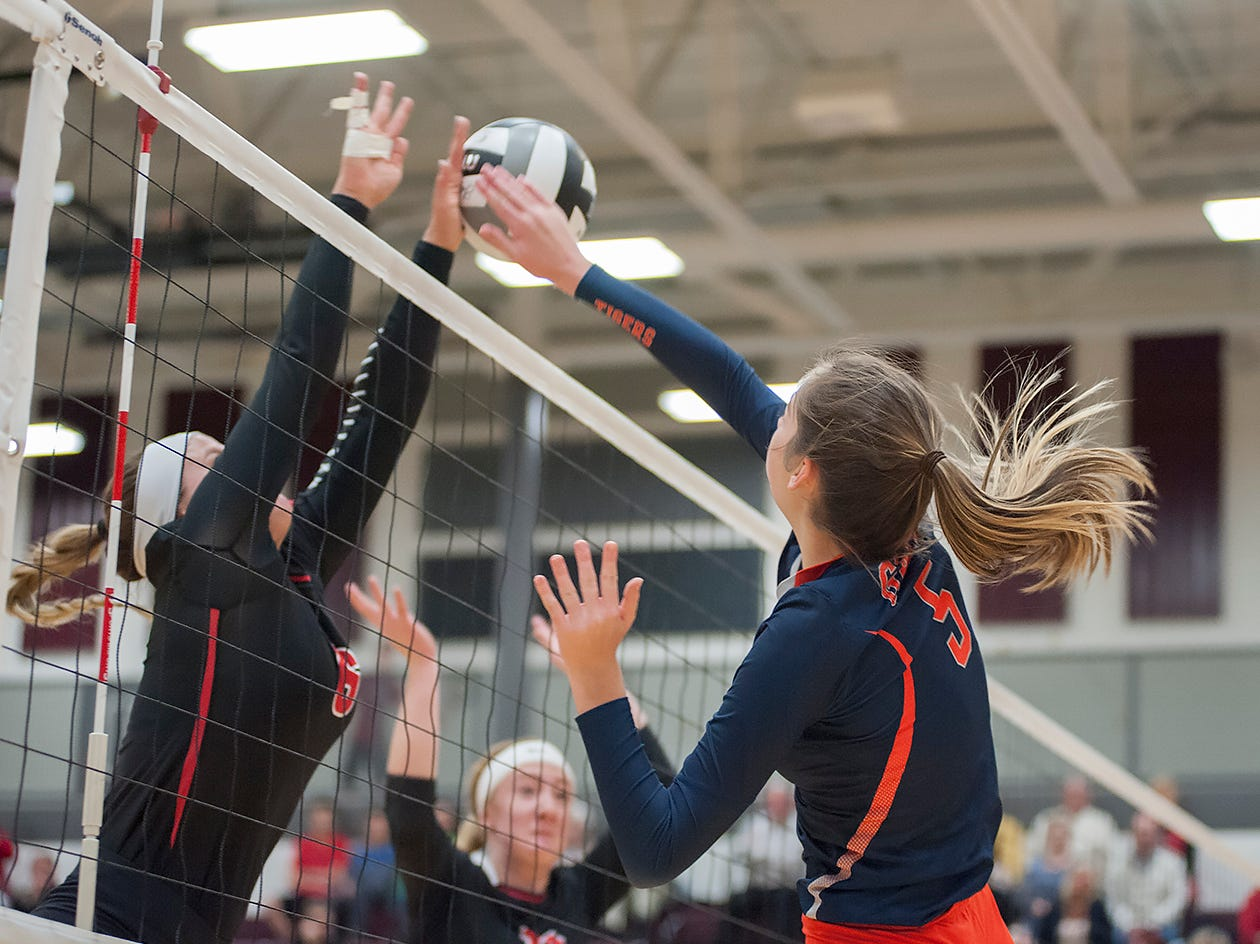 Galion's Gillian Miller hits the ball over the outstretched arms of Crestview's Magey Shambrae.