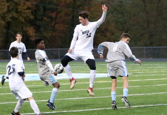 Burlington's Sean Clark (12) is playing in two high school playoff games on Friday as the Seahorses play at Middlebury in boys soccer and the SeaWolves meet host Rutland in the football quarterfinals.