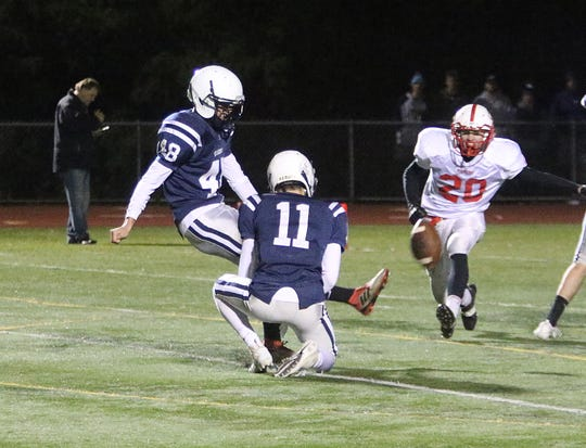 Sean Clark (48) is the kicker for the Burlington-South Burlington cooperative football team and he plays on the back line for the Seahorses' boys soccer team. Both teams will play road playoff games on Friday.