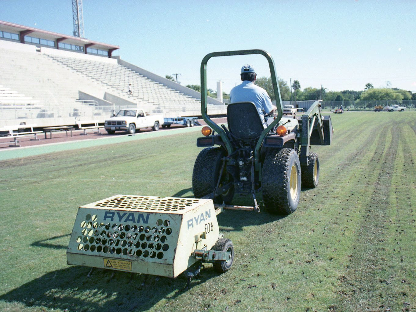 CCISD athletic groundsman Higinio Benavides aerates the field at Buc Stadium Oct. 14, 1997.  The grounds crew have been working since Saturday in an effort to save the sod, dry the field and make it playable by Friday.