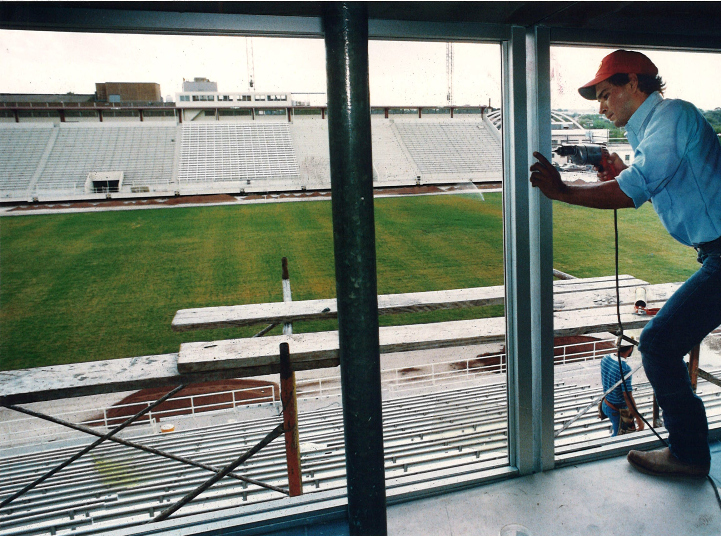 David Perez with Safety Glass of Corpus Christi works on the framing for new windows at the press box at Buccaneer Stadium on Aug. 25, 1992.