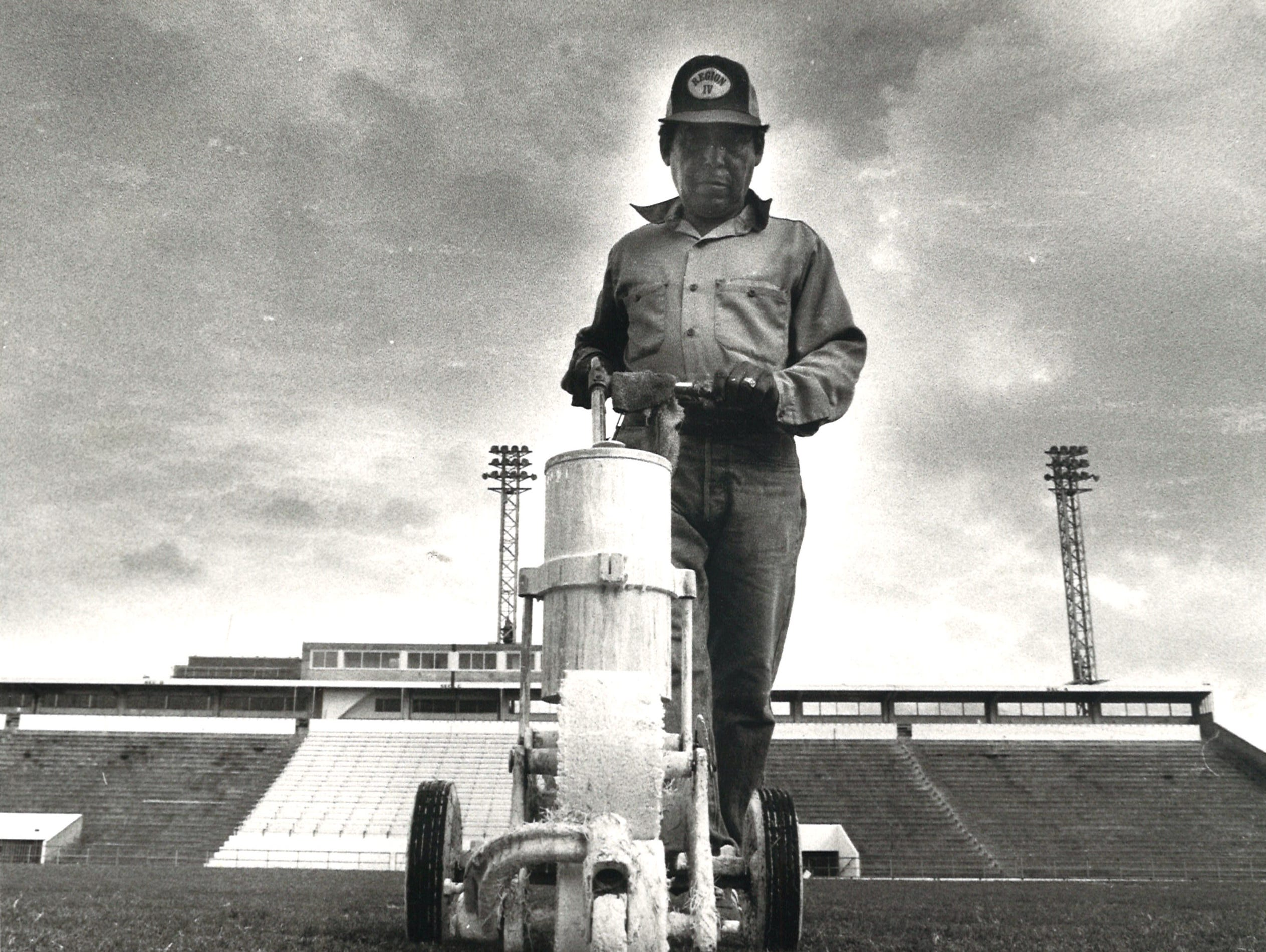 Shorty Guerrero helps prepare Buc Stadium for upcoming football games on Nov. 10, 1982. Guerrero was retired, but was asked to come back for the day to help out.