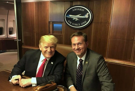 District 27 Congressman Michael Cloud, R-Corpus Christi, meets with President Donald Trump aboard Air Force One following a rally for Sen. Ted Cruz in Houston on Oct. 22, 2018.