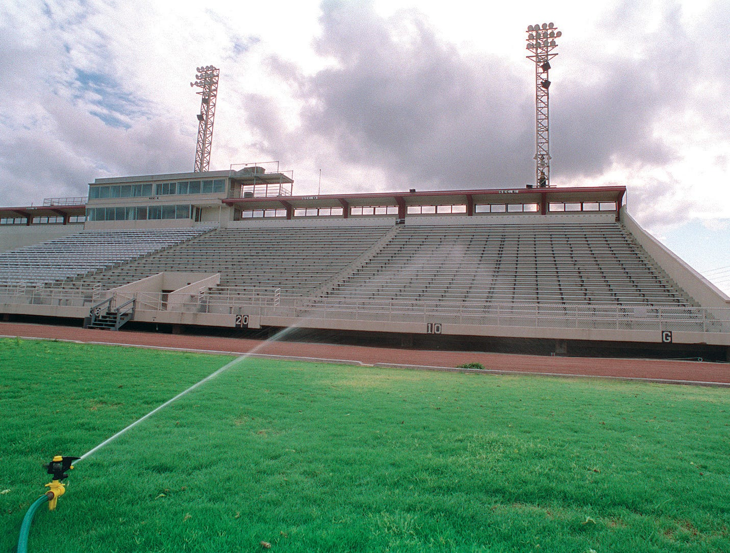 The Buc Stadium field received some much needed water from a sprinkler on some areas that have been drying out due to the drought on June 21, 1996.