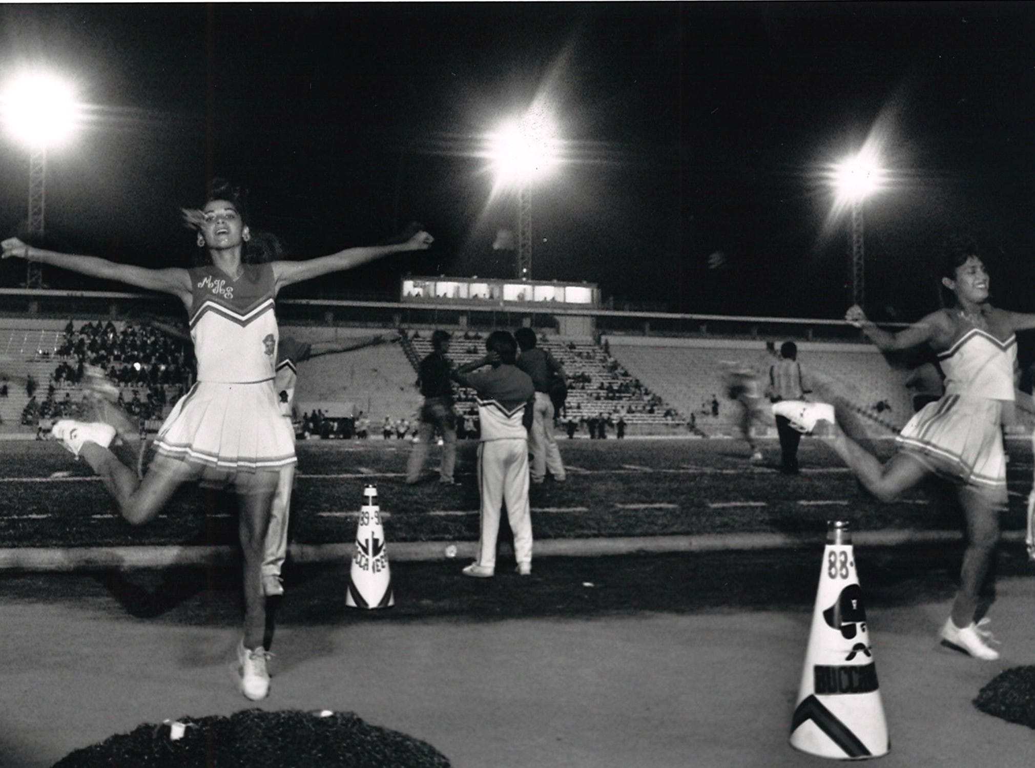 Belinda Ramirez (left) and Cindi Cardona (right) cheer for Miller before the game against Victoria Stroman on Sept. 28, 1989.