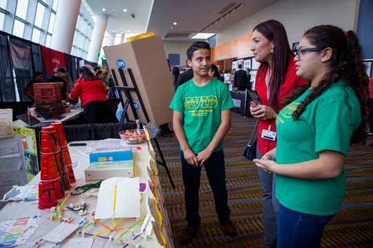 Cunningham Middle School students Tony Rocha (left), 12, and Gracye Cervantes (right), 12, talk with Fatima Zamarron (center) as they represent their school during the Hearts and Mind Showcase at the annual State of the District at the American Bank Center on Wednesday, October 24, 2018. The annual event provides an update on happenings with the Corpus Christi Independent School District and is the largest annual fundraising event benefitting the district.