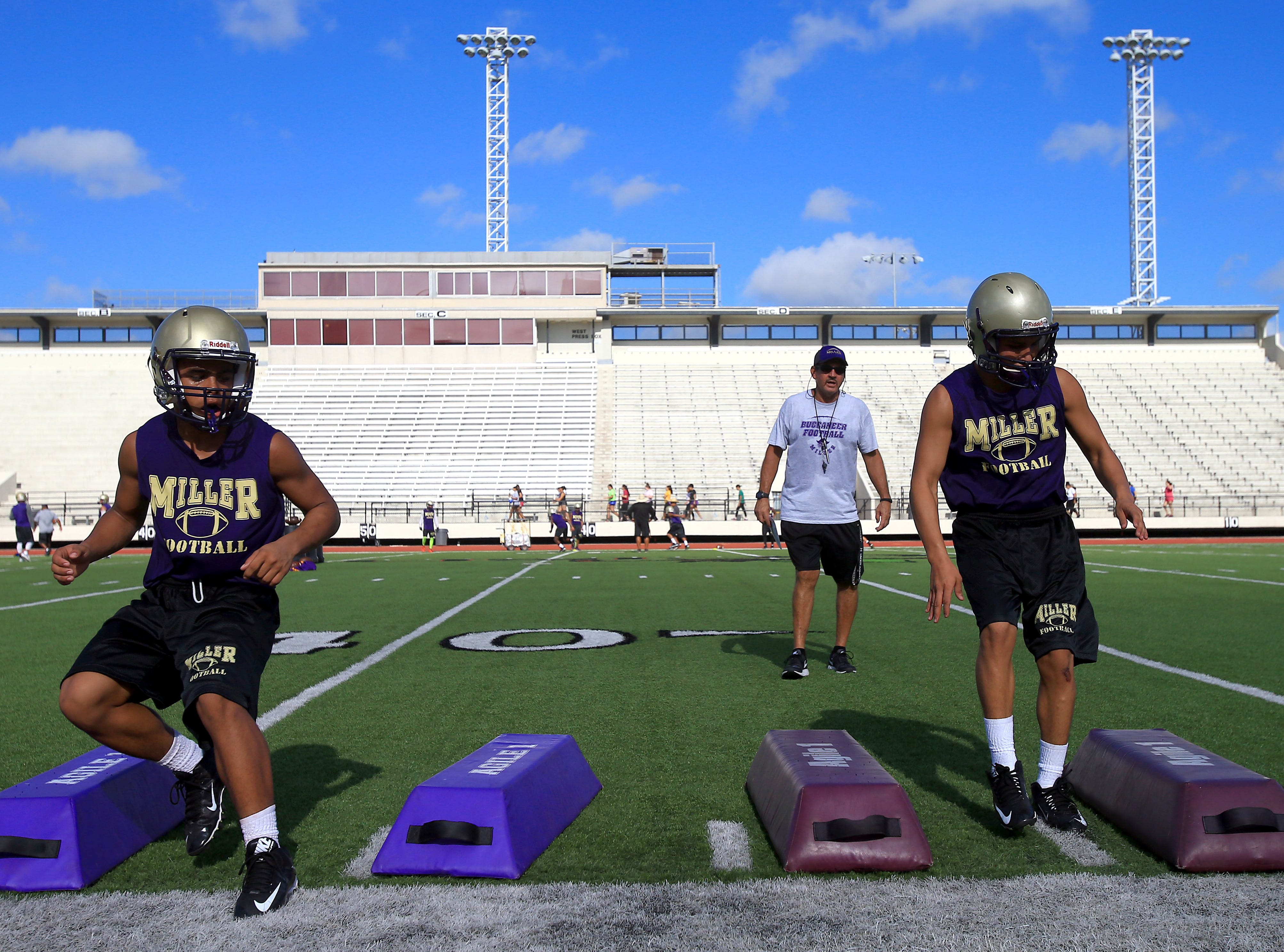 Miller players run through drills during practice Thursday, Aug. 4, 2016, at Buc Stadium in Corpus Christi.