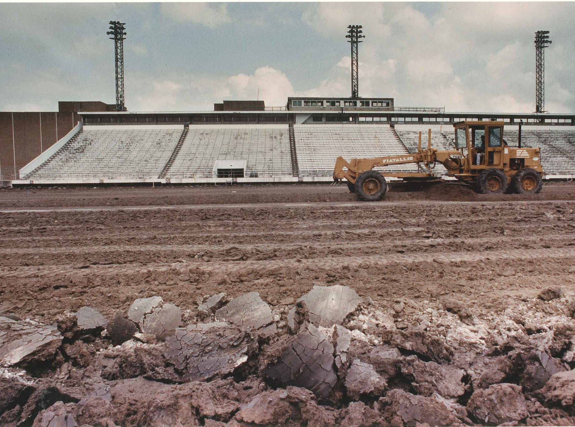 Caller-Times file Frank Lopez Jr. drives a grader to prepare the surface of the football field at Buccaneer Stadium in April 1992. The $2.1 million improvement project caused the Buccanneer Commission to cancel the Buc Days pre-parade stadium show that year.