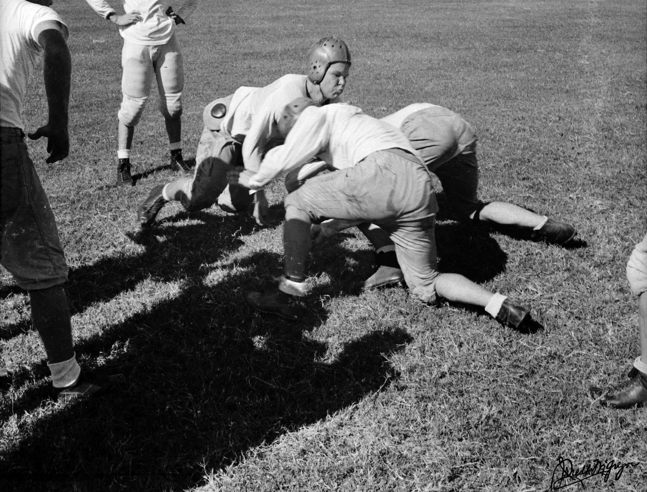 Members of the Corpus Christi High School football team practice at Buccaneer Stadium. 1 Battlin Buc Blvd, Corpus Christi. September 26, 1941.