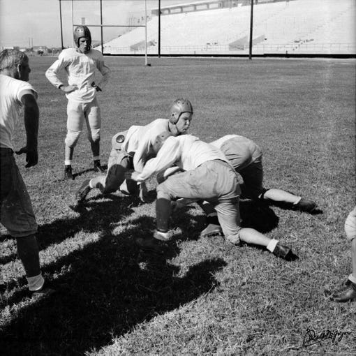 Members of the Corpus Christi High School football team practice at Buccaneer Stadium. 1 Battlin Buc Blvd, Corpus Christi. September 26, 1941.