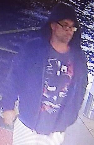 Police are searching for this man in connection with an attempted robbery of two vending machines outside a grocery store.