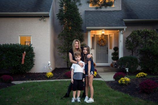 Mindie Barnett at home with her kids Julian Lichterman, 7, left, and Arielle Lichterman, 10, Tuesday, Oct. 9, 2018 in Voorhees, N.J.