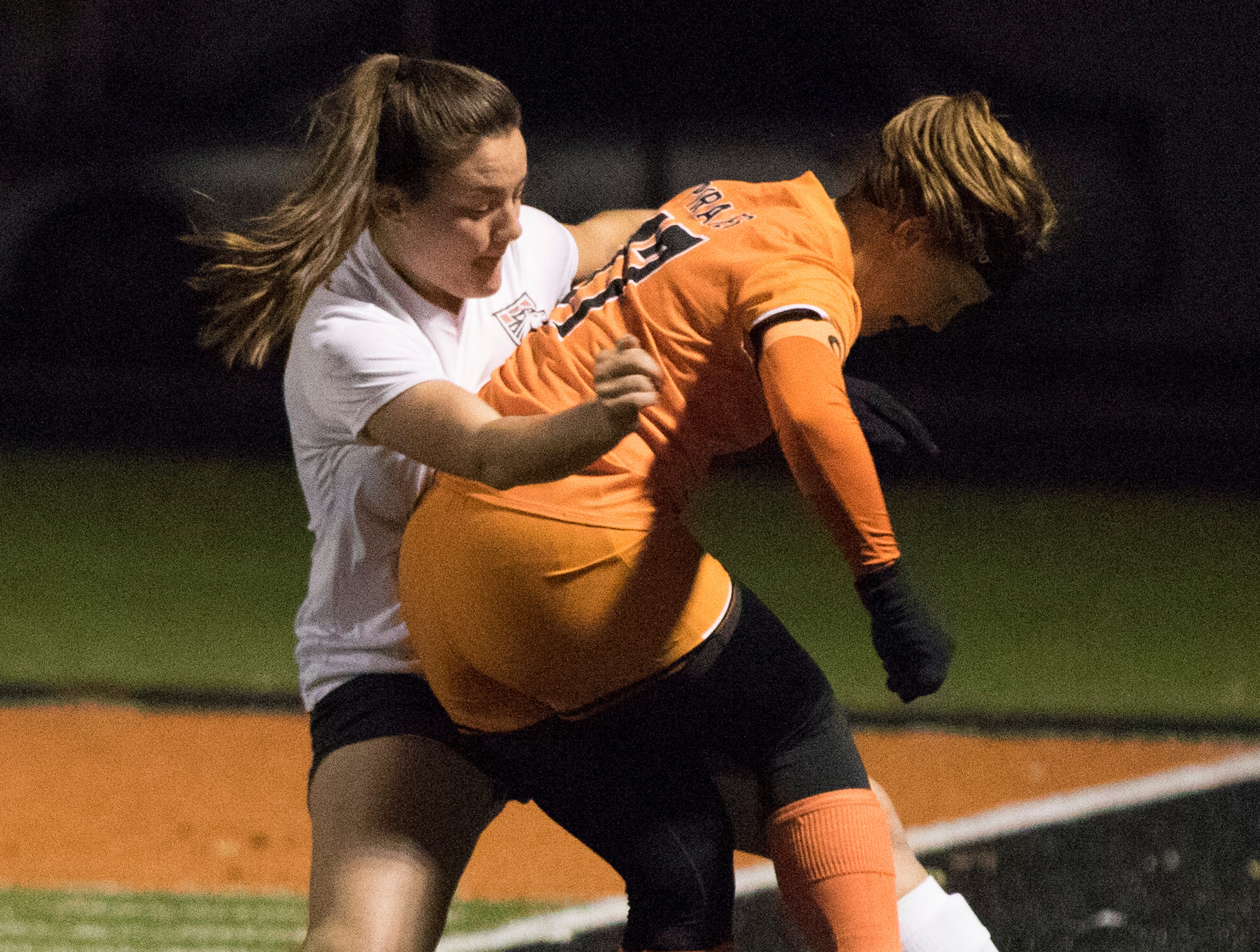 Westfall's Ariane Sias and Wheelersburg's Sophie Hagans battle for the ball during the first half of a division three district semifinals soccer matchup between the two schools Tuesday night. Westfall fell to Wheelersburg 1-0.