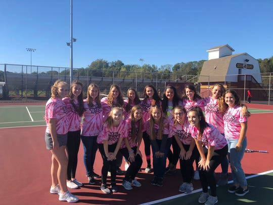 The Ross girls tennis team shows support for Gerri Bolin with breast cancer awareness shirts.