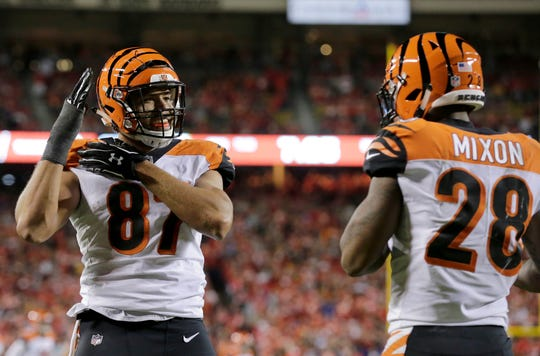 Cincinnati Bengals tight end C.J. Uzomah (87) dances the macarena with running back Joe Mixon (28) after scoring a touchdown in the second quarter of the NFL Week 7 game between the Kansas City Chiefs and the Cincinnati Bengals at Arrowhead Stadium in Kansas City, Mo., on Tuesday, Oct. 16, 2018.
