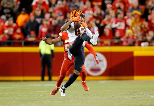 Cincinnati Bengals wide receiver Tyler Boyd (83) comes down with a catch in the third quarter of the NFL Week 7 game between the Kansas City Chiefs and the Cincinnati Bengals at Arrowhead Stadium in Kansas City, Mo., on Tuesday, Oct. 16, 2018. The Bengals lost 45-10, falling to 4-3 on the season.