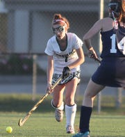 Amanda Hagedorn of Ursuline competes in a field hockey tournament game against MND.