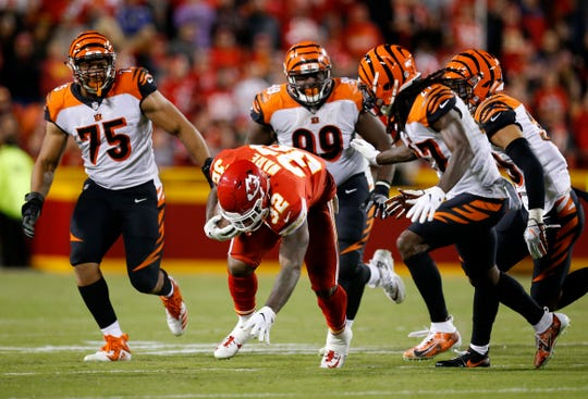 Kansas City Chiefs running back Spencer Ware (32) runs from a group of Bengals defenders in the fourth quarter of the NFL Week 7 game between the Kansas City Chiefs and the Cincinnati Bengals at Arrowhead Stadium in Kansas City, Mo., on Tuesday, Oct. 16, 2018. The Bengals lost 45-10, falling to 4-3 on the season.