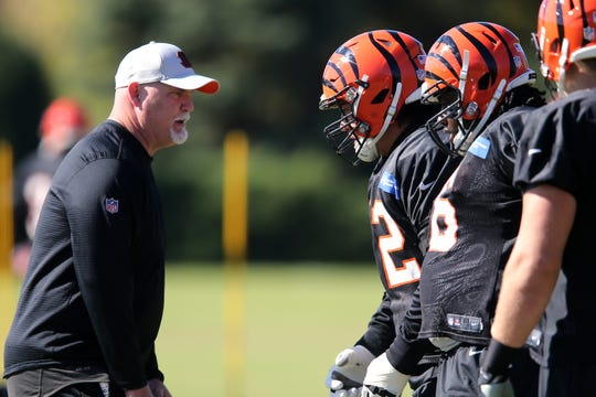 Cincinnati Bengals offensive line coach Frank Pollack works with Cincinnati Bengals offensive guard Alex Redmond (62) during practice, Wednesday, Oct. 24, 2018, on the practice fields next to Paul Brown Stadium in Cincinnati.