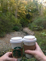 A fall-leaf strewn hike is warmed by sips of hot coffee along Whisky Run Creek in Mariemont.