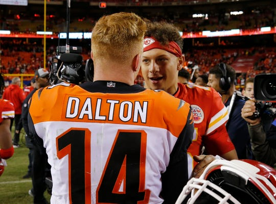 Cincinnati Bengals quarterback Andy Dalton (14) and Kansas City Chiefs quarterback Patrick Mahomes (15) shake hands after the fourth quarter of the NFL Week 7 game between the Kansas City Chiefs and the Cincinnati Bengals at Arrowhead Stadium in Kansas City, Mo., on Tuesday, Oct. 16, 2018. The Bengals lost 45-10, falling to 4-3 on the season.