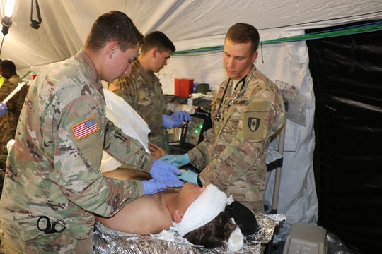 Soldiers from the 586th Field Hospital treat a simulated casualty in their new field hospital during a field exercise Oct. 16.  The training was the first time the unit was able to break out its new 148-bed field hospital platform since transitioning from the 86th Combat Support Hospital to the ArmyÕs new modular field hospital  platform. To date the Army has transitioned three of 10 combat support hospitalÕs to the new design. U.S. Army photo by Maria Yager.