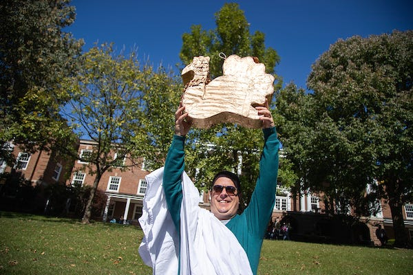 "Dr. Stephen Kershner holds up the ""eagle"" before it is sacrificed."