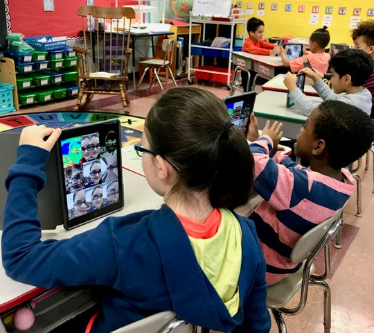 Second-graders in Kim Bachmann's technology class at School No. 1 learn to take photos with their iPads.