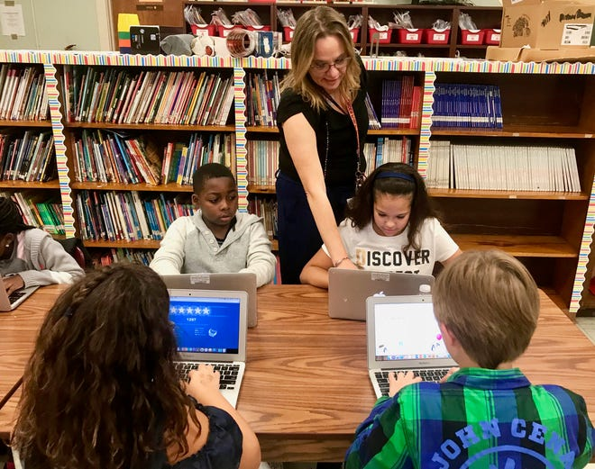 Elementary technology teacher Kim Marie Kefalas working with fourth-graders at Linden's School No. 10.