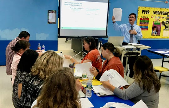 Thomas Dewing, a senior consultant at Silver Strong & Associates, leading a professional development session for teachers at Soehl Middle School on Oct. 8.