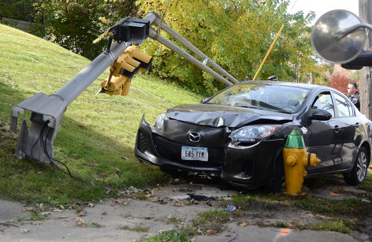 Windsor Heights police investigate a crash involving a stolen car Wednesday, Oct. 24, 2018, at University Ave and Merle Hay Road in Des Moines.