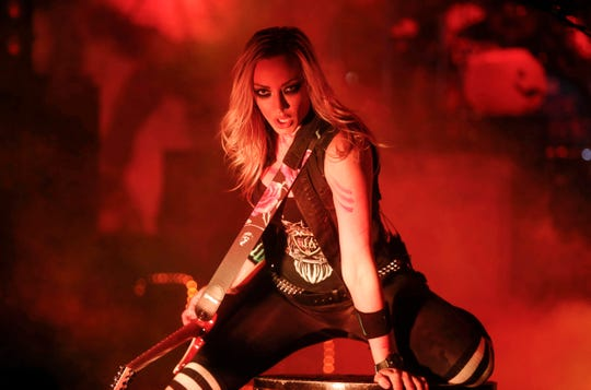 Nita Strauss, guitarist for rock and roll legend Alice Cooper, poses for a photo while performing on Tuesday, Oct. 23, 2018, at the Civic Center in Des Moines.