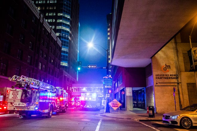 Firefighters investigate a possible fire in the Greater Des Moines Partnership's building on Tuesday, Oct. 23, 2018, in downtown Des Moines.