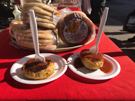 Two potato patties, called 'cutlets,' filled with a choice of beef or vegetables are sold at Saloo India at the Downtown Farmers' Market in Des Moines, along with homemade naan bread.