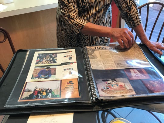 Saloo Sadiq has collected many articles and memorabilia over the years and put them all into a scrapbook.