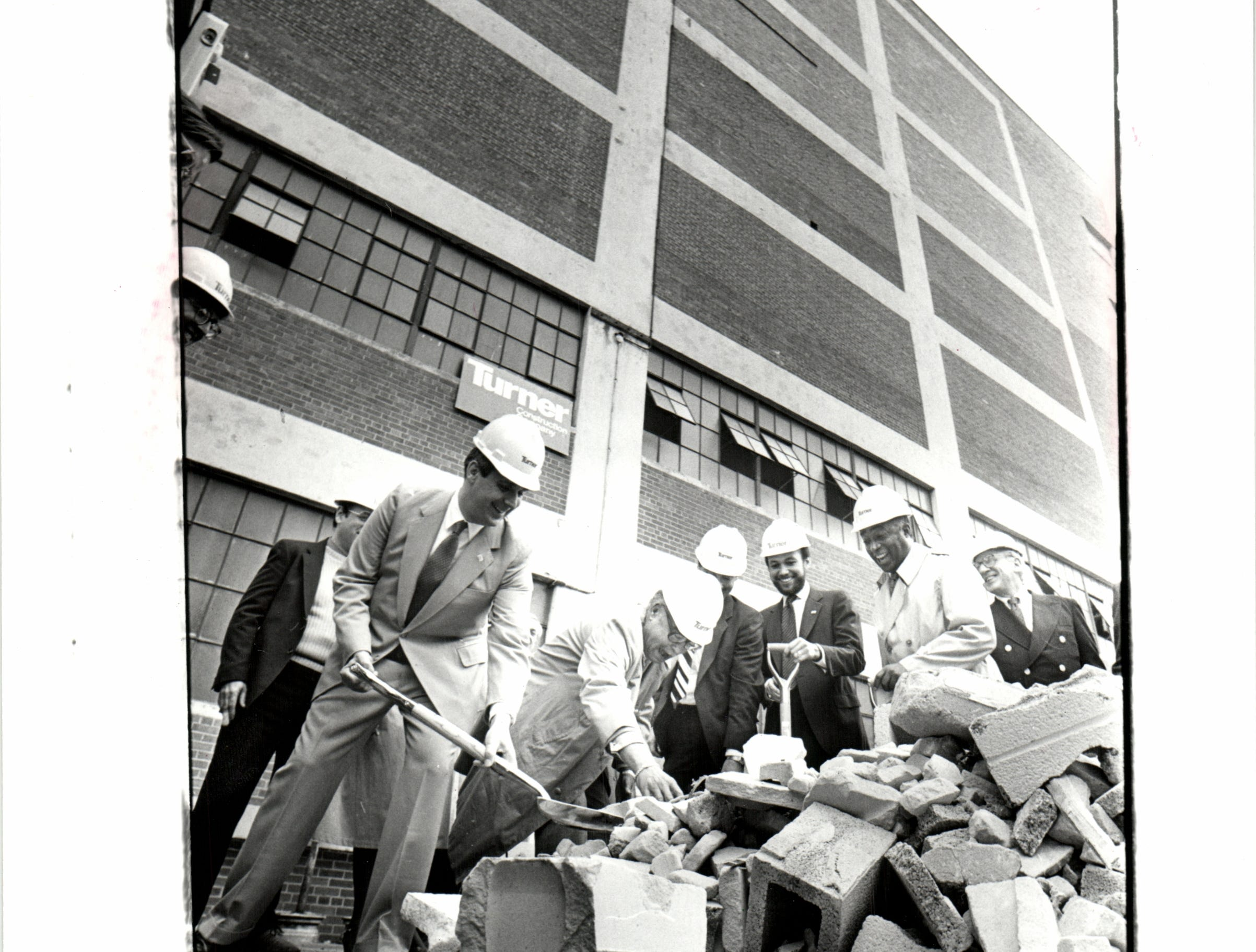 Developer J. M. Levin, left, and Mayor Young were among those who broke ground Thursday  for a $20 million renovation of the old Hudson's warehouse in downtown Detroit, Thirty Sixth district court.