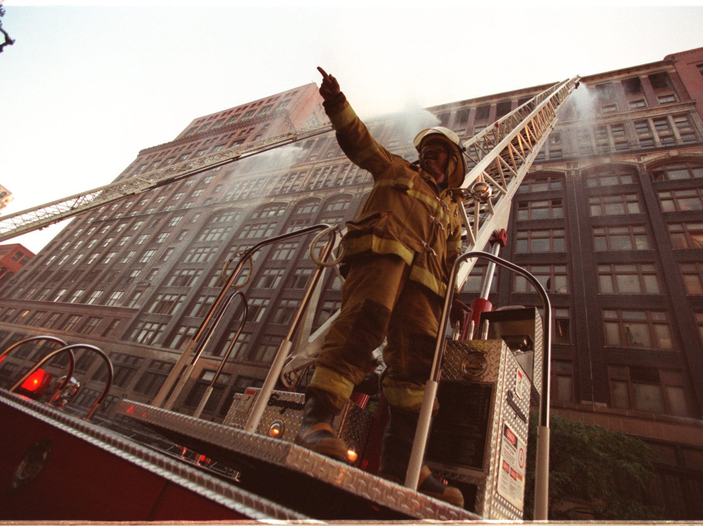 Senior fire fighter Jon Barrow,  Ladder 10/DFD in front of Hudson's building on Woodward.