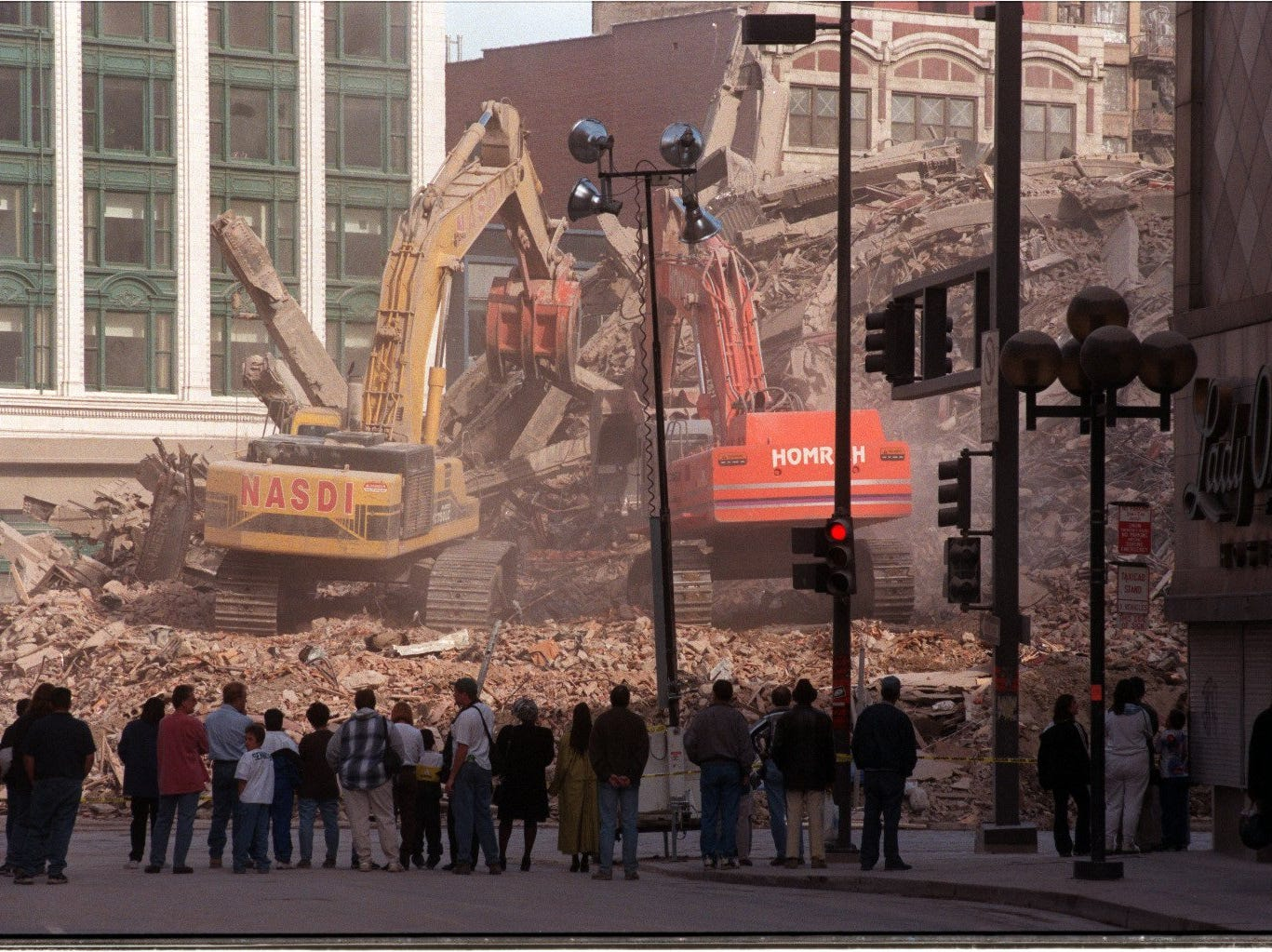 The mournful line Woodward as the bulldozers make final the grand old department store.  The old building became the number one tourist attraction in downtown Detroit.