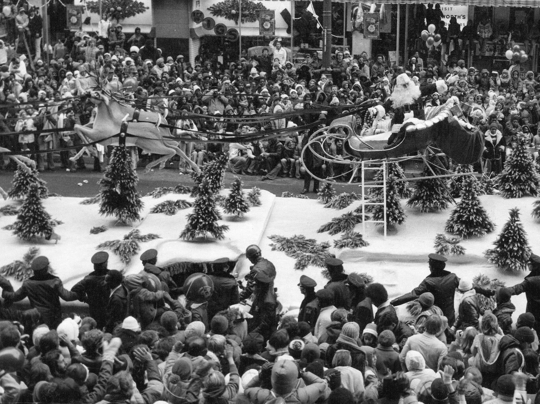 Santa Claus is going down Woodward Ave. arriving at J.L. Hudson's Department store in 1978. Santa is Father Joseph Marquis. In 2011, he is the pastor at Sacred Heart Byzantine Church in Livonia.