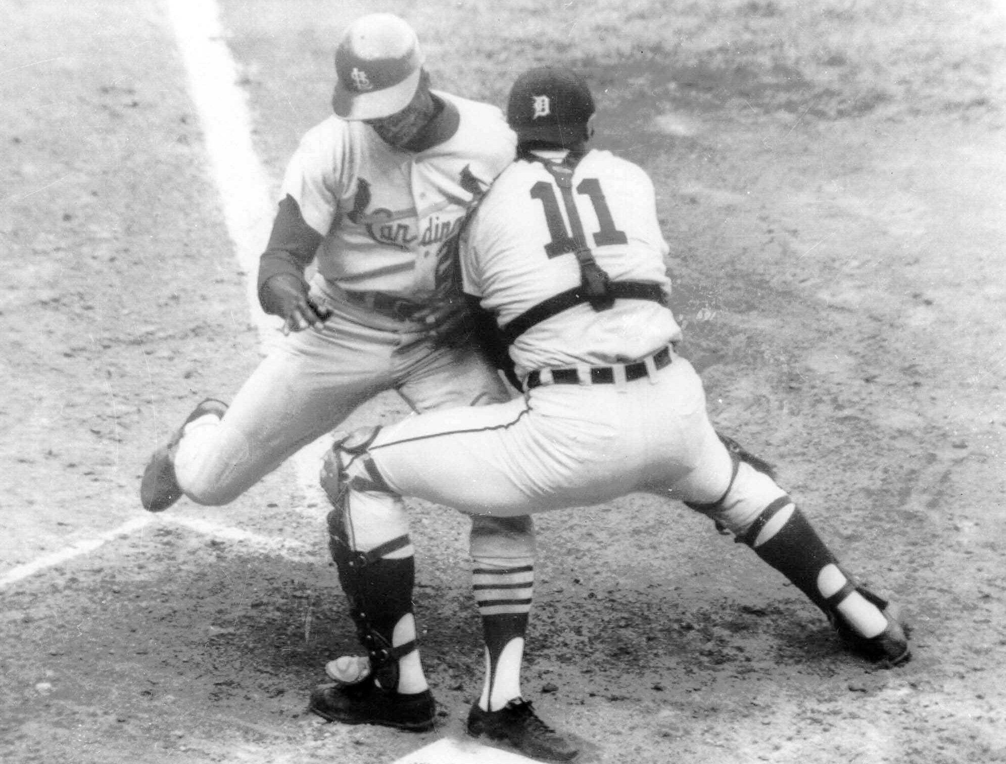 Tigers catcher Bill Freehan puts the tag on Cardinals outfielder Lou Brock on Oct. 7, 1968, at the plate in the fifth inning of Game 5 of World Series at Tiger Stadium. Brock was attempting to score on Julian Javier' single to left, but Tigers Willie Horton fired to the plate in time.
